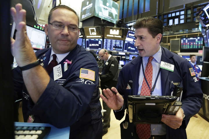 FILE- In this Aug. 22, 2018, file photo specialist Anthony Matesic, left, and trader Anthony Carannante work on the floor of the New York Stock Exchange. The U.S. stock market opens at 9:30 a.m. EDT on Thursday, Sept. 13. (AP Photo/Richard Drew, File)