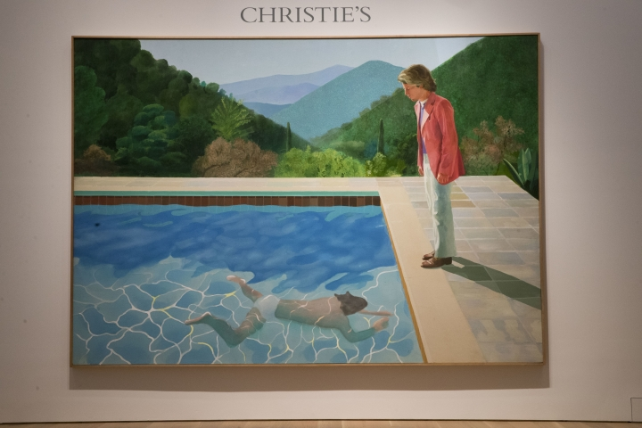 "David Hockney's ""Portrait of an Artist (Pool with Two Figures)"" is on display at Christie's auction house, Thursday, Sept. 13, 2018, in New York. One of the British artist's famous ""pool paintings"" will be auctioned at Christie's in November, and is considered one of his premier works. Christie's has estimated the work at about $80 million, but says it expects it to sell for more. (AP Photo/Mary Altaffer)"