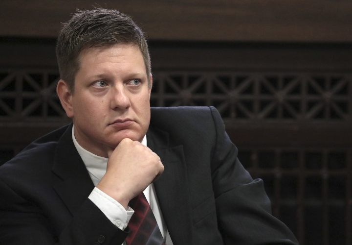 FILE - In this Thursday, Sept. 6, 2018, file photo, Chicago police Officer Jason Van Dyke, charged with first-degree murder in the shooting of black teenager Laquan McDonald in 2014, listens during a hearing at the Leighton Criminal Court Building in Chicago. Jury selection is expected to resume for the trial of Van Dyke after the effort was called off Tuesday, Sept. 11, 2018, due to a scheduling conflict for the trial's presiding Judge Vincent Gaughan. Van Dyke has pleaded not guilty. (Antonio Perez/Chicago Tribune via AP, Pool, File)