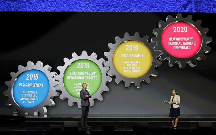 Johan Rockstrom, left, the Executive Director of the Stockholm Resilience Center and Christiana Figueres, Founding Partner, Global Optimism and Convenor, Mission 2020, give a presentation during the opening plenary of the Global Action Climate Summit Thursday, Sept. 13, 2018, in San Francisco. (AP Photo/Eric Risberg)