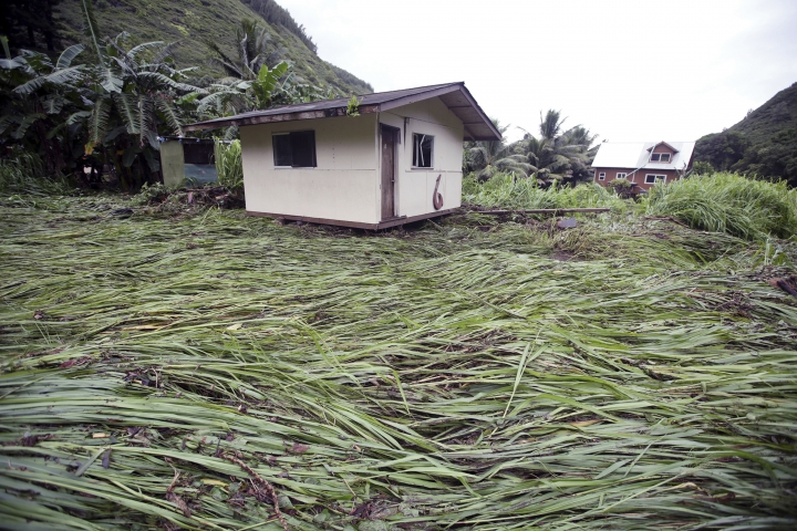A bedroom building sits atop downed vegetation after being swept up by floodwaters Wednesday, Sept. 12, 2018, in Maui's Honokohau Valley in Hawaii. Honolulu officials are preparing for the possible evacuation of 10,000 people from a residential neighborhood after rains from a tropical storm dangerously elevated water levels in a reservoir. Olivia dumped heavy rains on Maui and Oahu as it crossed the state. (Chris Sugidono/The Maui News via AP)