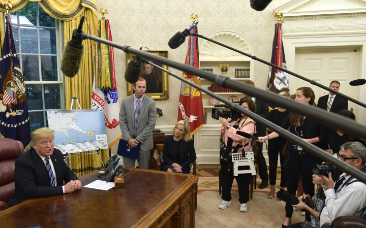 President Donald Trump, left, joined by FEMA Administrator Brock Long, second from left, and Homeland Security Secretary Kirstjen Nielsen, center, speaks during a briefing on Hurricane Florence in the Oval Office of the White House in Washington, Tuesday, Sept. 11, 2018. (AP Photo/Susan Walsh)
