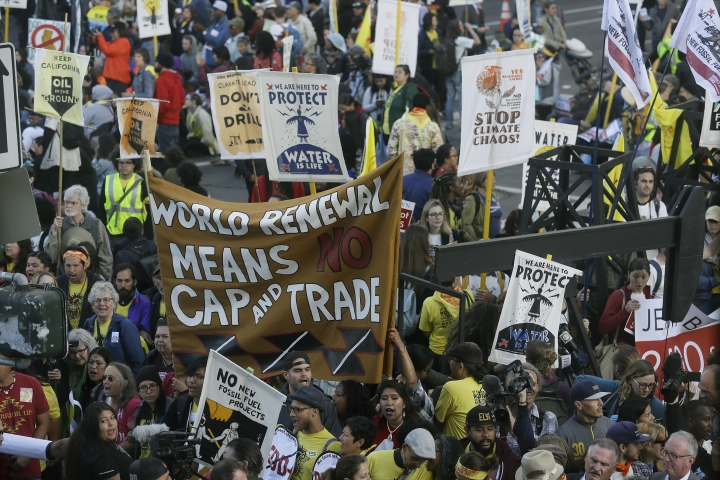 Protesters block an entrance to the Moscone Center where the Global Action Climate Summit was taking place Thursday, Sept. 13, 2018, in San Francisco. (AP Photo/Eric Risberg)