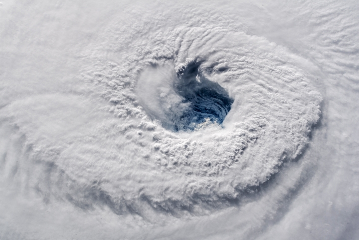 "In this Sept. 12, 2018 photo provided by NASA, Hurricane Florence churns over the Atlantic Ocean heading for the U.S. east coast as seen from the International Space Station. Astronaut Alexander Gerst, who shot the photo, tweeted: ""Ever stared down the gaping eye of a category 4 hurricane? It's chilling, even from space."" (Alexander Gerst/ESA/NASA via AP)"