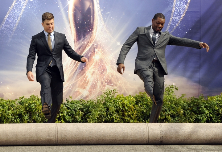 Colin Jost, left, and Michael Che, co-hosts for the 70th Emmy Awards, roll out the gold carpet outside the Microsoft Theatre, Thursday, Sept. 13, 2018, in Los Angeles. The awards will be held on Monday. (Photo by Chris Pizzello/Invision/AP)