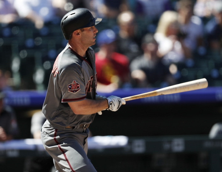 Arizona Diamondbacks' Paul Goldschmidt grounds out against Colorado Rockies starting pitcher Kyle Freeland in the first inning of a baseball game Thursday, Sept. 13, 2018, in Denver. (AP Photo/David Zalubowski)