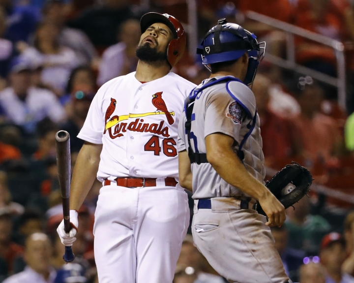 St. Louis Cardinals' Francisco Pena, left, reacts after being called out on strikes, as Los Angeles Dodgers catcher Austin Barnes looks on during the seventh inning of a baseball game Thursday, Sept. 13, 2018, in St. Louis. (AP Photo/Billy Hurst)
