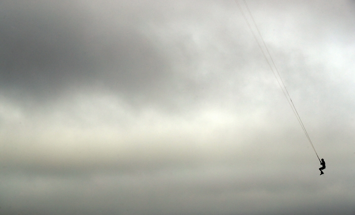Bob Bowman, from Virginia Beach, Va., gets some air as he kiteboards, Thursday, Sept. 13, 2018, in Virginia Beach, Va., as Hurricane Florence moves towards the eastern shore. (AP Photo/Alex Brandon)