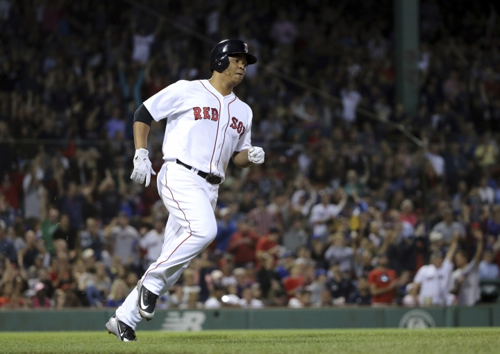 Boston Red Sox's Rafael Devers rounds the bases on a solo home run in the sixth inning of a baseball game against the Toronto Blue Jays at Fenway Park, Thursday, Sept. 13, 2018, in Boston. (AP Photo/Elise Amendola)