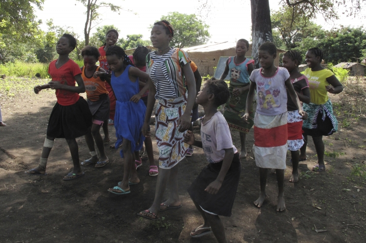 In this photo taken Friday, April 20, 2018 in the Gorongosa National Park, Mozambique, Mozambican girls dance as part of a girls' club program that aims to help girls stay in school longer and stay out of child marriage, a longstanding problem in the southern African country. About 50 girls clubs have been set up by the managers of Gorongosa National Park, who believe that human development and conservation go hand in hand. (AP Photo/Christopher Torchia)