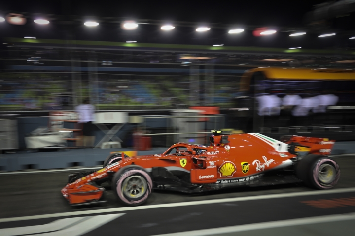 Ferrari driver Kimi Raikkonen of Finland leaves the pit during second practice at the Marina Bay City Circuit ahead of the Singapore Formula One Grand Prix in Singapore, Friday, Sept. 14, 2018. (AP Photo/Vincent Thian)