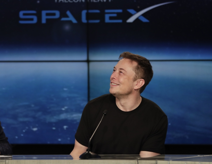 FILE - In this Feb. 6, 2018 file photo, Elon Musk, founder, CEO, and lead designer of SpaceX, speaks at a news conference after the Falcon 9 SpaceX heavy rocket launched successfully from the Kennedy Space Center in Cape Canaveral, Fla. SpaceX says it's signed the first private moon traveler. The big reveal on who it is _ and when the flight to the moon will be _ is scheduled for Monday, Sept. 17, 2018. (AP Photo/John Raoux)