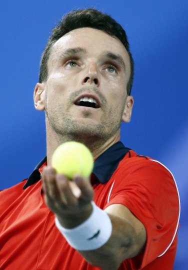Spain's Roberto Bautista Agut prepares to serve to France's Lucas Pouille during the Davis Cup semifinals France against Spain, Friday, Sept.14, 2018 in Lille, northern France. (AP Photo/Michel Spingler)