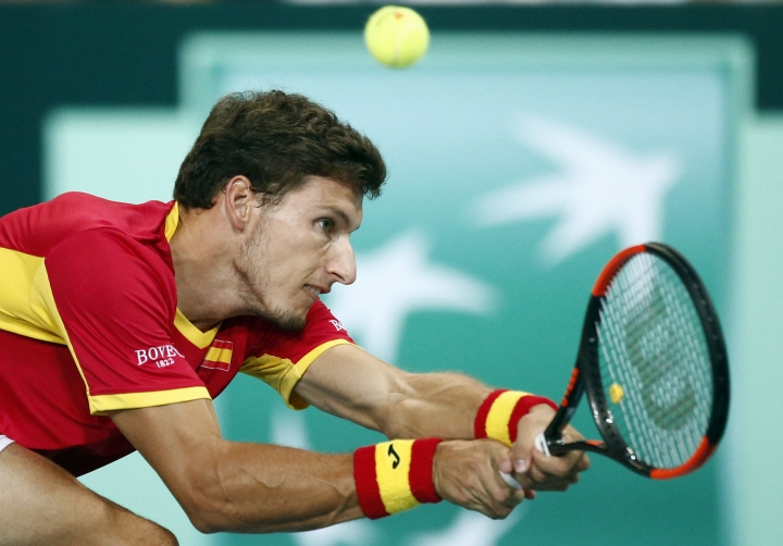 Spain's Pablo Carreno Busta returns the ball to France's Benoit Paire during the Davis Cup semifinals France against Spain, Friday, Sept.14, 2018 in Lille, northern France. (AP Photo/Michel Spingler)
