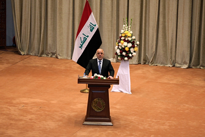 Iraq Prime Minister Haider al-Abadi addresses a newly elected parliament during its first session in Baghdad, Iraq, Monday, Sept. 3, 2018. Iraq's newly elected parliament held its first session as two blocs, both claiming to hold the most seats, vied for the right to form a new government. (AP Photo/Karim Kadim)
