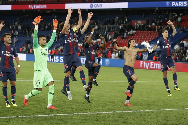 PSG players celebrate their 4-0 win after their French League One soccer match between Paris-Saint-Germain and Saint-Etienne at the Parc des Princes stadium in Paris, Friday, Sept. 14, 2018. (AP Photo/Michel Euler)
