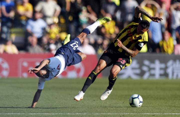 Tottenham's Lucas Moura, left, collides with Watford's Jose Holebas during the English Premier League soccer match between Watford FC and Tottenham Hotspur at Vicarage Road stadium in Watford, England, Sunday, Sept 2, 2018. (AP Photo/Frank Augstein)