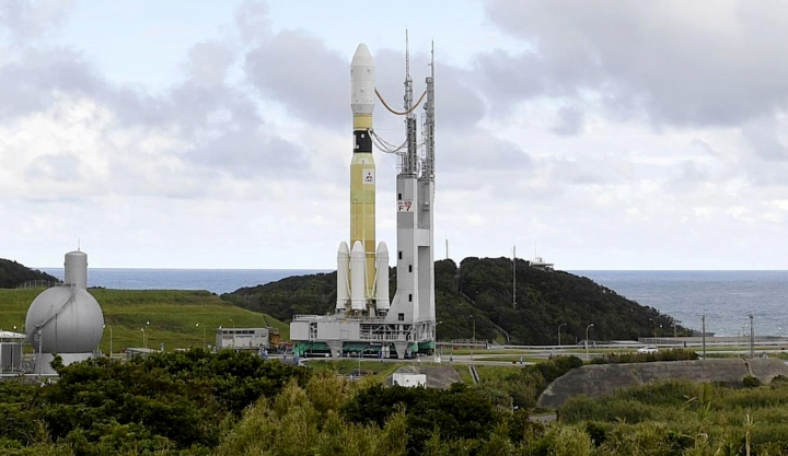 In this Sept. 14, 2018, photo, an H-2B rocket carrying the Kounotori 7 cargo spacecraft is seen at Tanegashima Space Center in the southwestern Japan prefecture of Kagoshima. The Japanese supply run to the International Space Station has been delayed again. The countdown was halted Saturday, Sept. 15, in Japan, with only a few hours remaining before liftoff. Earlier in the week, a typhoon delayed the launch.(Kyodo News via AP)