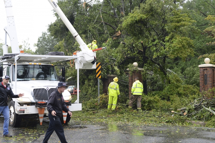 Rains from Hurricane Florence fall as crews remove tree limbs from a power line on Herritage Street Friday, Sept. 14, 2018, in Kinston, N.C. (Janet S. Carter/Daily Free Press via AP)