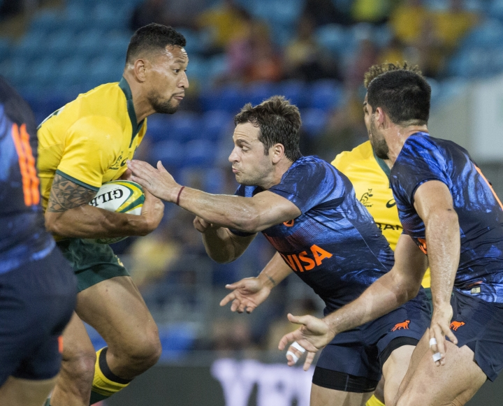 Argentina's Nicolas Sanchez, center, tackles Australia's Israel Folau during their rugby union test match in the Gold Coast, Australia, Saturday, Sept. 15, 2018. (AP Photo/Dave Kapernick)