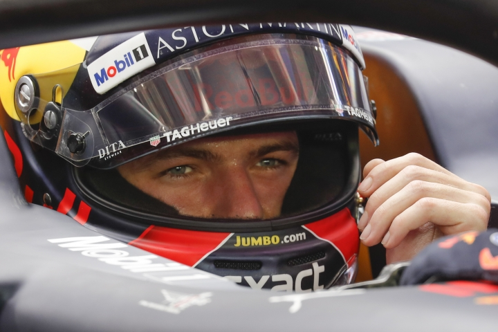 Red Bull Racing driver Max Verstappen of Netherlands prepares in his car during third practice at the Marina Bay City Circuit ahead of the Singapore Formula One Grand Prix in Singapore, Saturday, Sept. 15, 2018. (AP Photo/Vincent Thian)