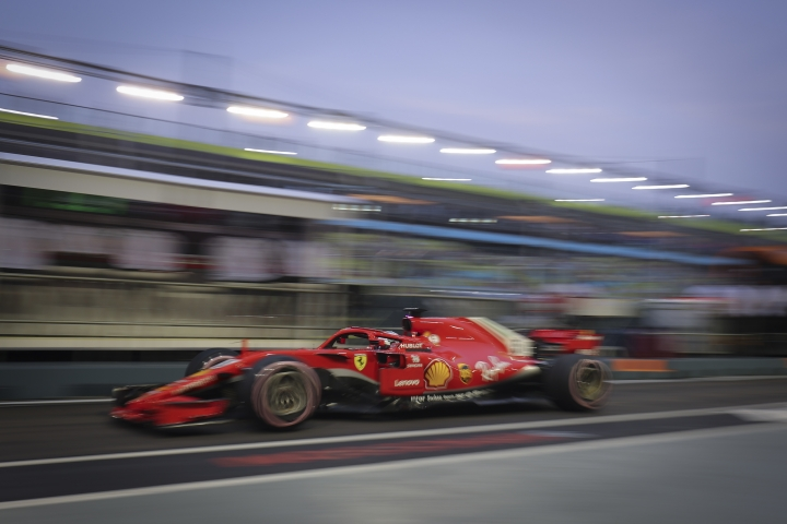 Ferrari driver Sebastian Vettel of Germany leaves the pit during third practice at the Marina Bay City Circuit ahead of the Singapore Formula One Grand Prix in Singapore, Saturday, Sept. 15, 2018. (AP Photo/Vincent Thian)