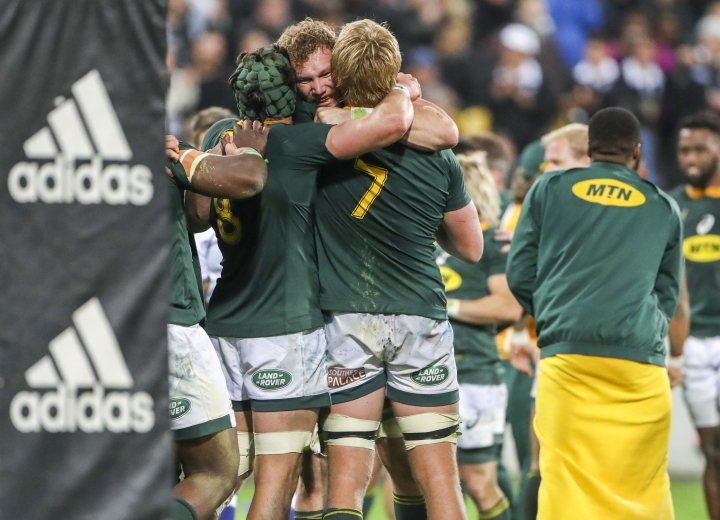 South Africa's players celebrate their win in a rugby championship test match between South Africa and New Zealand in Wellington, New Zealand, Saturday, Sept. 15, 2018. (AP Photo/John Cowpland)