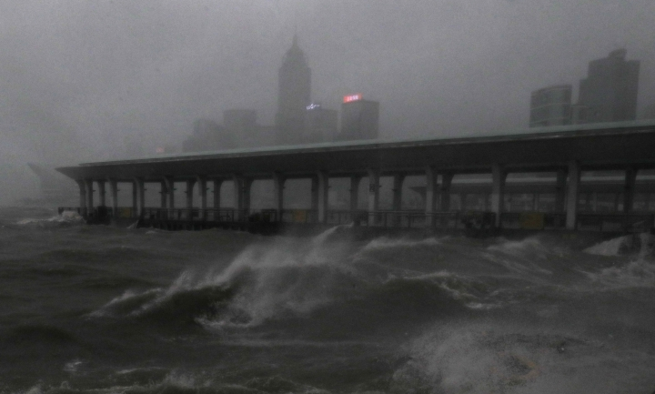 Strong wind caused by Typhoon Mangkhut churns waves on the waterfront of Victoria Habour Hong Kong, Sunday, Sept. 16, 2018. AP Photo/Vincent Yu)