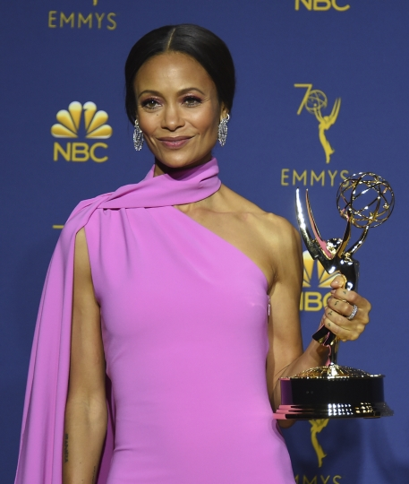 """Thandie Newton, winner of the award for outstanding supporting actress in a drama series for """"Westworld"""" poses in the press room at the 70th Primetime Emmy Awards on Monday, Sept. 17, 2018, at the Microsoft Theater in Los Angeles. (Photo by Jordan Strauss/Invision/AP)"""
