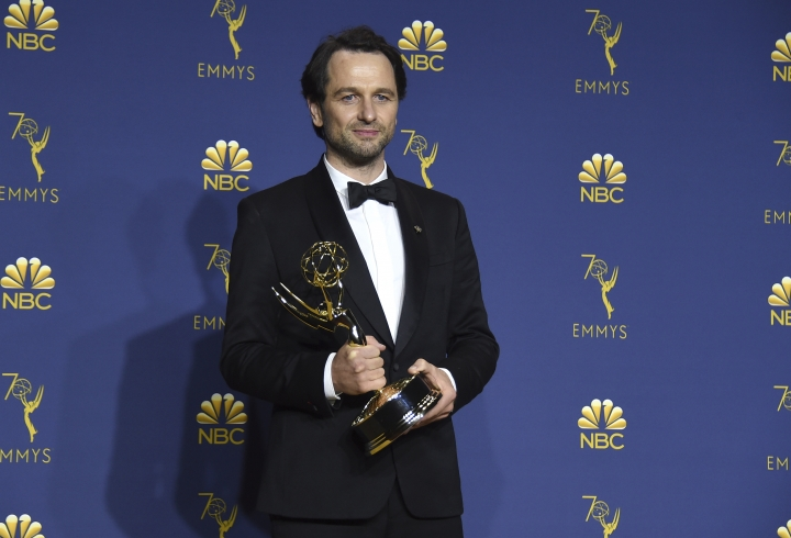 """Matthew Rhys, winner of the award for outstanding lead actor in a drama series for """"The Americans"""", poses in the press room at the 70th Primetime Emmy Awards on Monday, Sept. 17, 2018, at the Microsoft Theater in Los Angeles. (Photo by Jordan Strauss/Invision/AP)"""