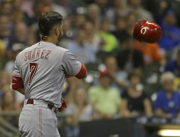 Cincinnati Reds' Eugenio Suarez tosses his helmet after striking out during the third inning of a baseball game against the Milwaukee Brewers Monday, Sept. 17, 2018, in Milwaukee. (AP Photo/Aaron Gash)