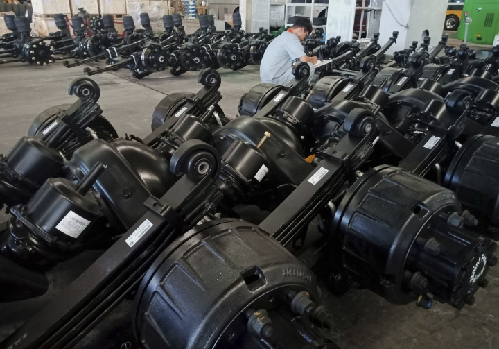 In this Aug. 29, 2018, photo, a man works in an auto parts factory in Liaocheng in eastern China's Shandong province. The Trump administration announced Monday, Sept. 17, 2018, that it will impose tariffs on $200 billion more in Chinese goods starting next week, escalating a trade war between the world's two biggest economies and potentially raising prices on goods ranging from handbags to bicycle tires. (Chinatopix via AP)