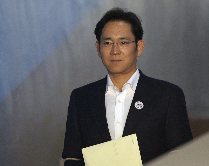 "FILE - In this Feb. 5, 2018, file photo, Lee Jae-yong, vice chairman of Samsung Electronics, arrives at the Seoul High Court for a hearing in Seoul, South Korea. South Korean President Moon Jae-in heads to his meeting with North Korea's leader with a huge civilian entourage including the third-generation heir of South Korea's largest business group and a Colorado-born pop diva nicknamed the ""Korean Beyonce."" The inclusion of billionaire Samsung scion Lee Jae-yong in the South Korean delegation has been a controversial decision as he has been a key figure in the corruption scandal surrounding former South Korean President Park Geun-hye. (AP Photo/Ahn Young-joon, Pool, File)"