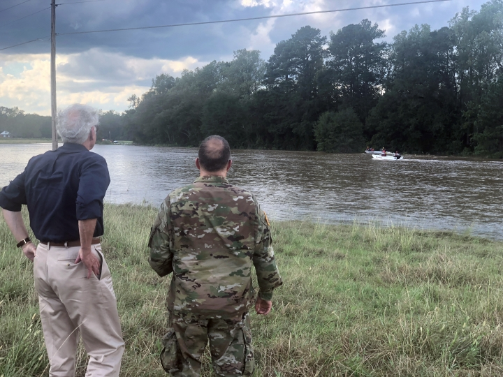 South Carolina Gov. Henry McMaster, left, and U.S. Army Lt. Col. John McElveen look on as a Swift Water squad from Louisiana bring two stranded motorists to safety in Chesterfield County, South Carolina on Monday, Sept. 17, 2018. McMaster spotted the men sprawled on top of their flooded vehicle while he was taking a helicopter flight around South Carolina's northeastern area observing flooded areas from Hurricane Florence. (AP Photo/Meg Kinnard)