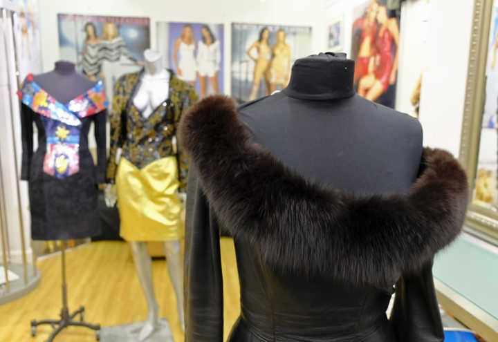 FILE - This March 15, 2018, file photo shows a vintage fox trimmed leather dress displayed in the basement of a store in San Francisco. Los Angeles would become the largest city in the U.S. to ban the sale of fur products if the City Council approves a proposed law backed by animal activists who say the multibillion-dollar fur industry is rife with cruelty. (AP Photo/Eric Risberg, File)