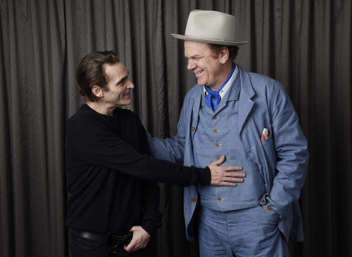"""In this Sept. 8, 2018 photo, Joaquin Phoenix, left, and John C. Reilly, cast members in the film """"The Sisters Brothers,"""" pose together for a portrait at the Adelaide Hotel during the Toronto International Film Festival in Toronto. (Photo by Chris Pizzello/Invision/AP)"""