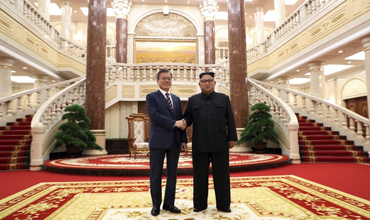 North Korean leader Kim Jong Un, right, shakes hands with South Korean President Moon Jae-in before their summit at the headquarters of the Central Committee of the Workers' Party in Pyongyang, North Korea, Tuesday, Sept. 18, 2018. (Pyongyang Press Corps Pool via AP)