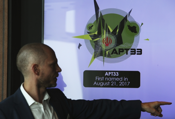 Alister Shepherd, the director of a subsidiary of the cybersecurity firm FireEye, gestures during a presentation about the APT33 hacking group, which his firm suspects are Iranian government-aligned hackers, in Dubai, United Arab Emirates, Tuesday, Sept. 18, 2018. FireEye warned Tuesday that Iranian government-aligned hackers have stepped up their efforts in the wake of President Donald Trump pulling America from the nuclear deal. (AP Photo/Jon Gambrell)