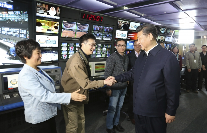FILE - In this Feb. 19, 2016, file photo released by China's Xinhua News Agency, Chinese President Xi Jinping, right, shakes hands with staff members at the control room of China Central Television (CCTV) in Beijing. China said Wednesday, Sept. 19, 2018, that it has reached out to the U.S. over reports that the Department of Justice has ordered Chinese state-run media outlets, Xinhua News Agency and CGTN, the international arm of state broadcaster CCTV, to register with the government as foreign agents. (Ma Zhancheng/Xinhua via AP, File)