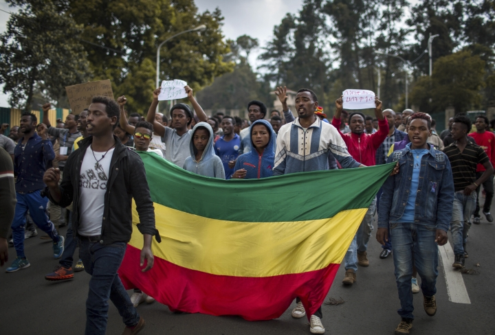 "Thousands of protestors from the capital and those displaced by ethnic-based violence over the weekend in Burayu, demonstrate to demand justice from the government in Addis Ababa, Ethiopia Monday, Sept. 17, 2018. Several thousand Ethiopians have gone out onto the streets of the capital to protest ethnic-based attacks in the outskirts of the city in which more than 20 people died over the weekend. Three banners in Amharic from left to right read ""Justice for the people of Amhara, Tigray and Southerners"", ""Stop ethnic-based attacks"" and ""One mouth, but two tongues"". (AP Photo/Mulugeta Ayene)"