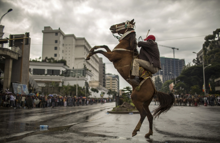 An Ethiopian rides a horse as hundreds of thousands gather to welcome returning leaders of the once-banned Oromo Liberation Front (OLF) in the capital Addis Ababa, Ethiopia Saturday, Sept. 15, 2018. The OLF and two other organizations were removed from a list of terror groups earlier this year after Prime Minister Abiy Ahmed took office, amid sweeping reforms to bring opposition groups back to politics. (AP Photo/Mulugeta Ayene)