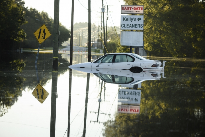 Flooding on Clinton Road at Cedar Creek Road on Wednesday, Sept. 19, 2018, in Fayetteville, N.C. (Andrew Craft /The Fayetteville Observer via AP)
