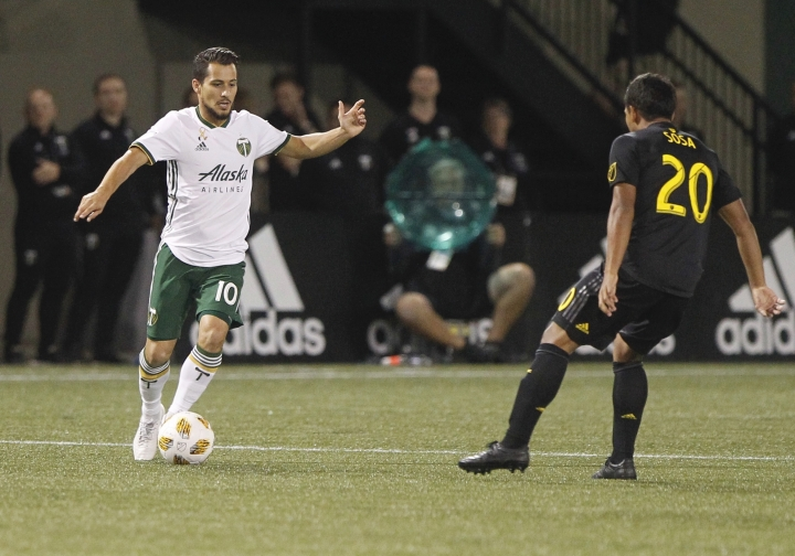 Portland Timbers' Sebastian Blanco (10) works against Columbus Crew's Eduardo Sosa (20) during a Major League Soccer match Wednesday, Sept. 19, 2018, in Portland, Ore. (Sean Meagher/The Oregonian via AP)