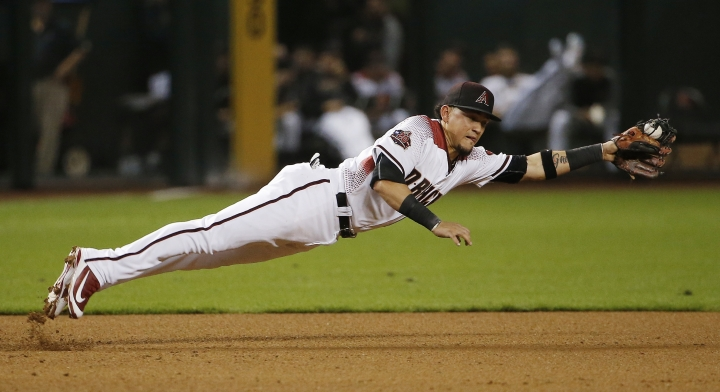 Arizona Diamondbacks third baseman Ildemaro Vargas catches a grounder hit by Chicago Cubs' David Bote before throwing to first base for the out during the fifth inning of a baseball game Wednesday, Sept. 19, 2018, in Phoenix. (AP Photo/Ross D. Franklin)