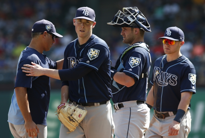 Tampa Bay Rays manager Kevin Cash, left, removes pitcher Ryan Yarbrough from the game against the Texas Rangers as catcher Nick Ciuffo and first baseman Jake Bauers look on during the sixth inning of a baseball game Wednesday, Sept. 19, 2018, in Arlington, Texas. (AP Photo/Mike Stone)