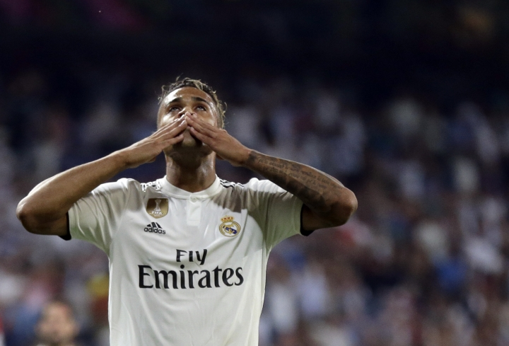 Real forward Mariano Diaz celebrates after scoring his side's third goal during a Group G Champions League soccer match between Real Madrid and Roma at the Santiago Bernabeu stadium in Madrid, Spain, Wednesday Sept. 19, 2018. (AP Photo/Manu Fernandez)