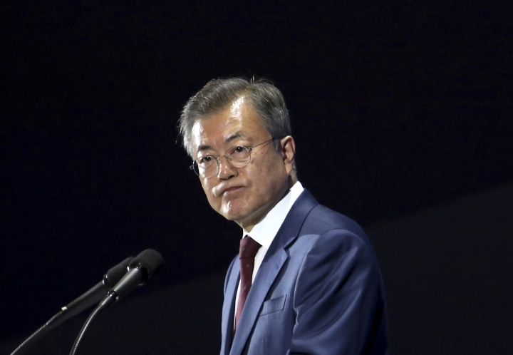South Korean President Moon Jae-in listens to a question during a press conference after returning from North Korea at the main press center in Seoul, South Korea, Thursday, Sept. 20, 2018. The leaders of the rival Koreas took to the road for the final day of their summit Thursday, standing on the peak of a beautiful volcano considered sacred in the North and a centerpiece of propaganda used to legitimize the Kim family's rule, their hands clasped and raised in a pose of triumph. Their trip to the mountain on the North Korean-Chinese border, and the striking photo-op that will resonate in both Koreas, followed a day of wide-ranging agreements they trumpeted as a major step toward peace.(AP Photo/Ahn Young-joon)