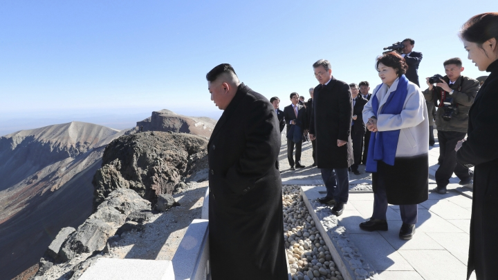 South Korean President Moon Jae-in, second from left, and his wife Kim Jung-sook, second from right, North Korean leader Kim Jong Un, left, and his wife Ri Sol Ju, right, visit Mount Paektu in North Korea, Thursday, Sept. 20, 2018. (Pyongyang Press Corps Pool via AP)