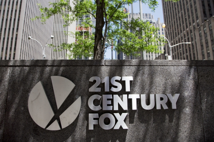 FILE - In this file photo dated Thursday, June 14, 2018, the 21st Century Fox logo is shown outside its New York office. British regulators say that the corporate battle between 21st Century Fox and Comcast to take over broadcaster Sky will be settled by auction, commencing at 5 p.m. on Sept. 21 and ending on the evening of Sept. 22, 2018. (AP Photo/Mark Lennihan, FILE)