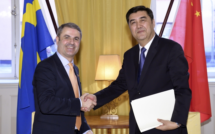"FILE - In this March 23, 2017 file photo, China's Energy Minister Nur Bekri, right, shakes hands with Sweden's Minister for Energy Ibrahim Baylan at the Swedish Government headquarters Rosenbad in Stockholm. The head of China's energy planning agency, one of the most senior officials from the Uighur ethnic minority in China's Muslim northwest, is suspected of unspecified ""severe discipline violations,"" the official term for corruption, the ruling Communist Party's discipline agency said Friday, Sept. 21, 2018. (Henrik Montgomery/TT News Agency via AP, File)"